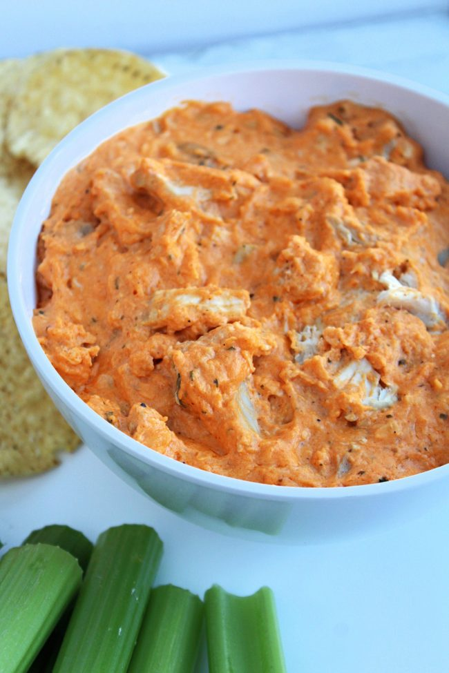 Buffalo Chicken Dip with tortilla chips and celery