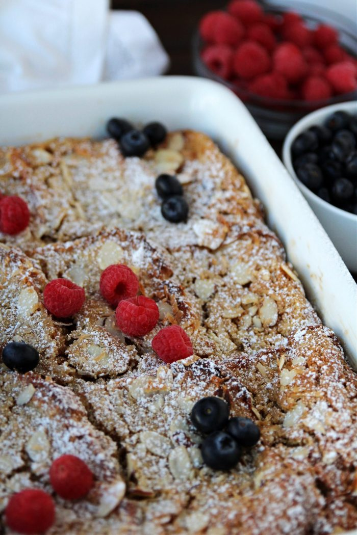 french toast casserole with berries on top
