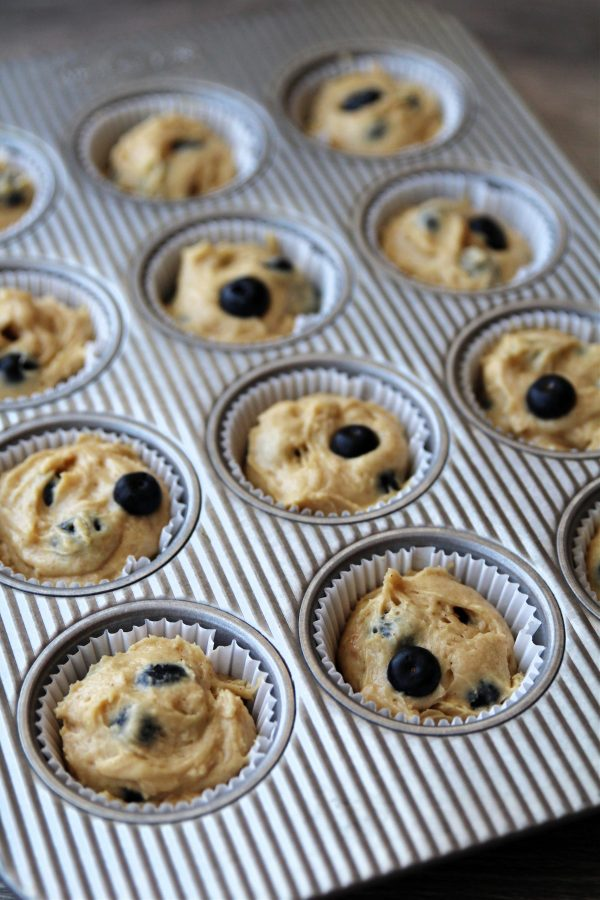 Image of blueberry muffin batter in muffin pan