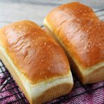 Picture of two loaves of honey white bread