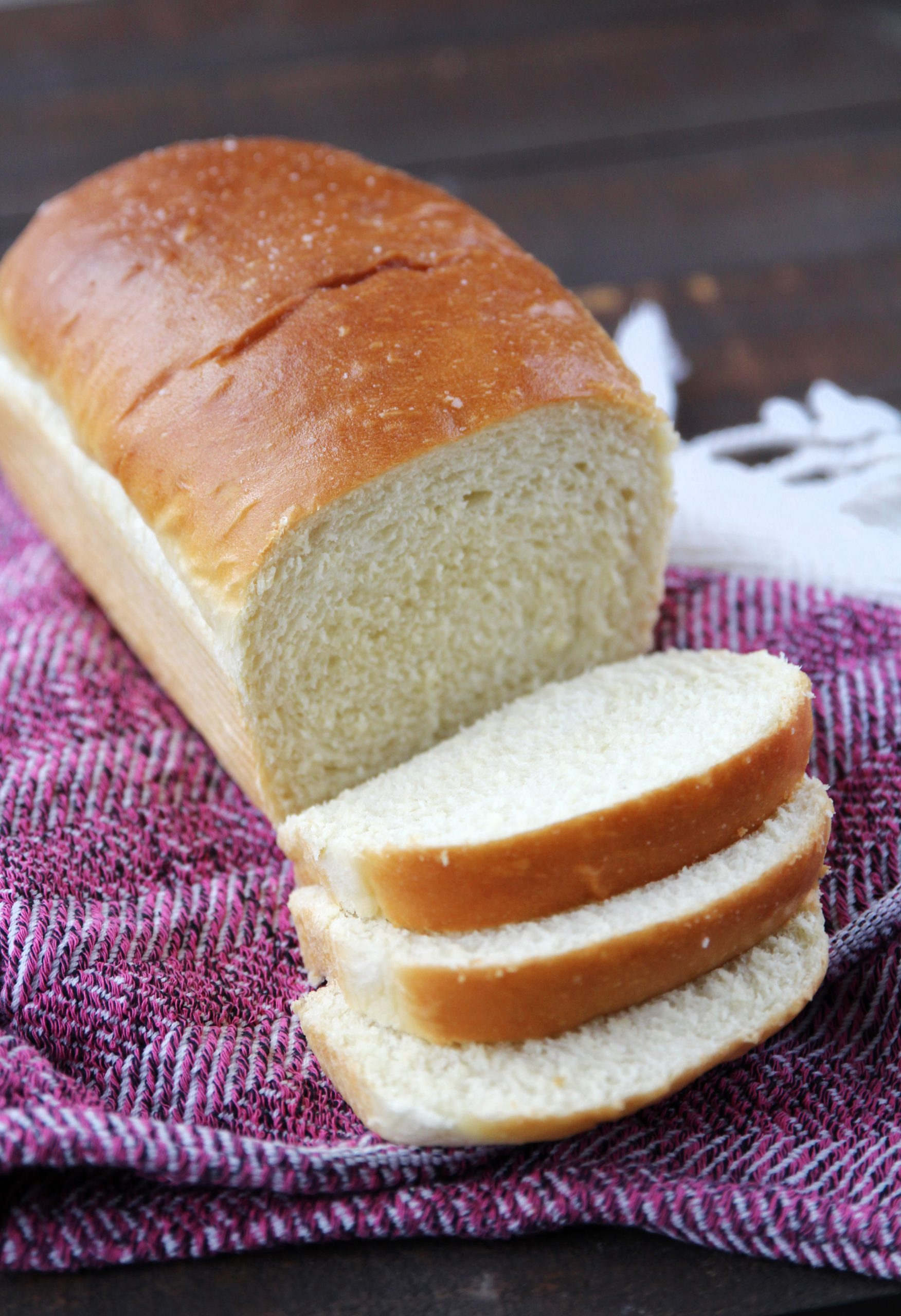 Loaf of white bread with a few slices cut