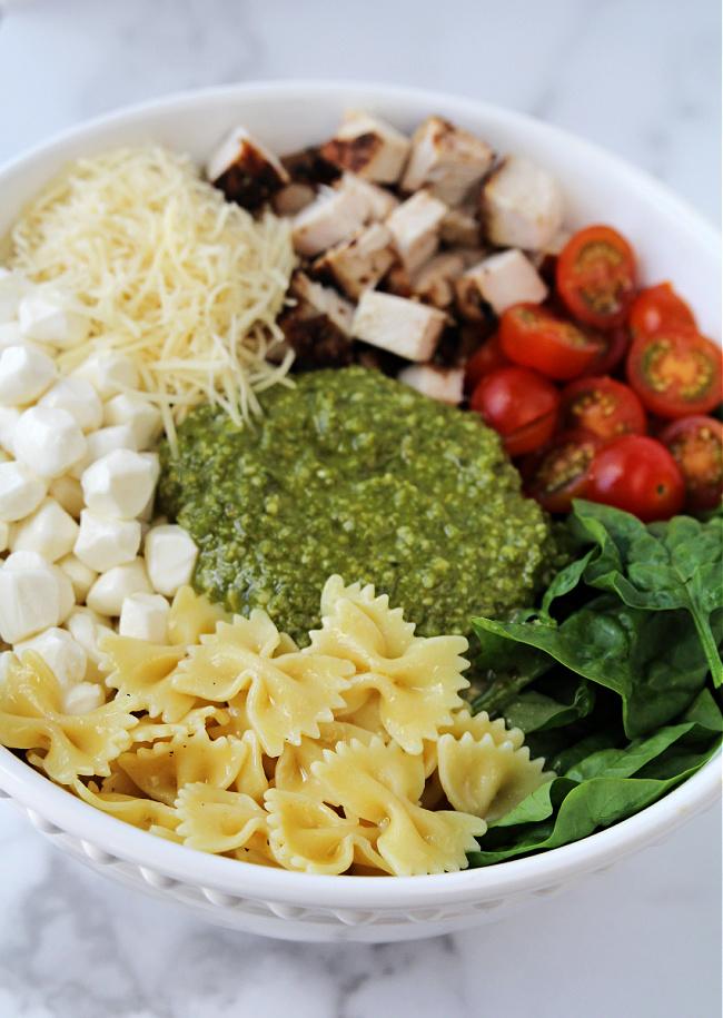 bowl of ingredients in Chicken Pesto Pasta Salad